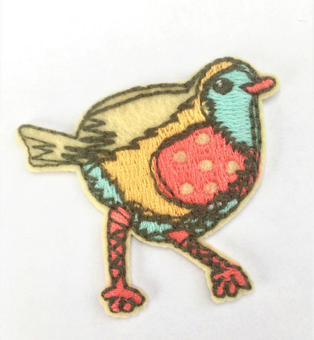 Tepsutteleva lintu-koristekuvio