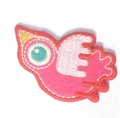 Pinkki lintu-koristekuvio