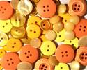 Keltaisen- ja oranssinsävyiset napit