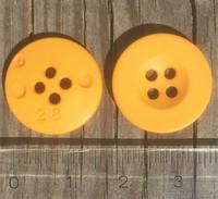Okrankeltainen nappi, 18 mm