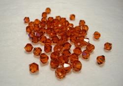 Swarovski kristallihelmi tumma oranssi/terracotta bicone 4 mm (5/pss)