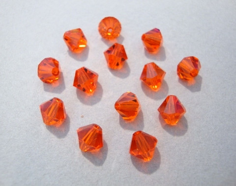 Swarovski kristallihelmi oranssi bicone 6 mm (4/pss)