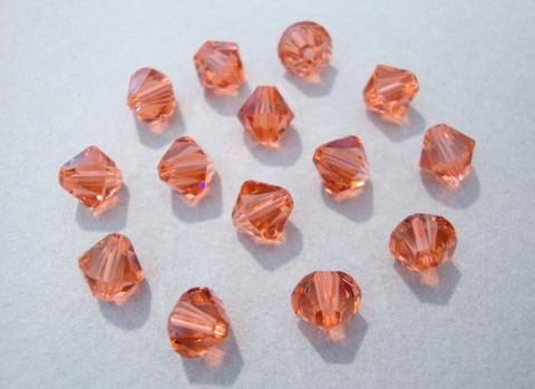 Swarovski kristallihelmi punainen (Padparadscha) bicone 6 mm (4/pss)