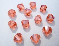 Swarovski kristallihelmi punainen (Padparadscha) bicone 8 mm (4/pss)