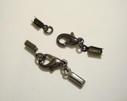 Nauhanpää 1-2 mm nauhalle, liimattava + rapulukko 10 mm musta (5/pss)