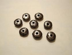 TierraCast Metallihelmi/välihelmi Heishi musta nuggetti 7 mm (20 kpl/pss)
