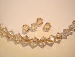Swarovski kristallihelmi kulta Golden shadow bicone 6 mm (4/pss)