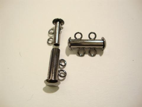 Putkilukko 2:lle koruvaijerille/nauhalle musta 16 x6 mm