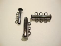 Putkilukko 3:lle koruvaijerille/nauhalle musta 21 x 6 mm