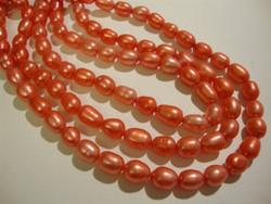 Makeanvedenhelmi punainen soikea 6 - 7 mm (38 cm nauha)