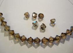 Swarovski kristallihelmi pronssinvärinen bicone 6 mm (4 kpl/pss)