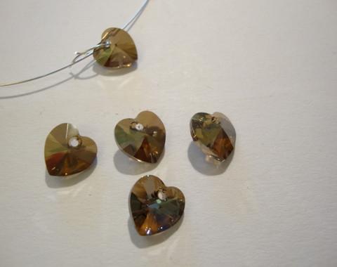 Swarovski kristalli sydänriipus pronssinvärinen 10 mm