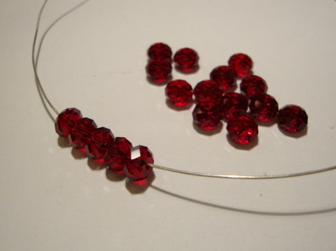 Swarovski kristallihelmi punainen Siam rondelli 4 x 6 mm (4/pss)