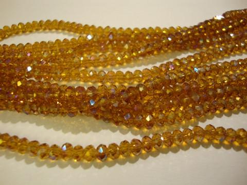 Kristallihelmi meripihkan ruskea AB rondelli 3 x 4 mm (n. 50/nauha)