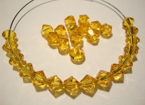 Swarovski kristallihelmi auringonkukan keltainen bicone 6 mm (4/pss)