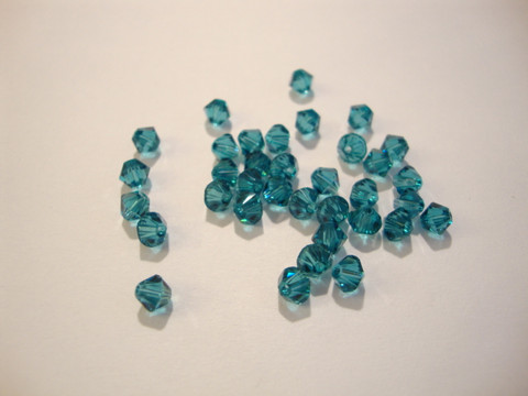 Swarovski kristallihelmi Indicolite turkoosi/vihreä bicone 4 mm (5/pss)