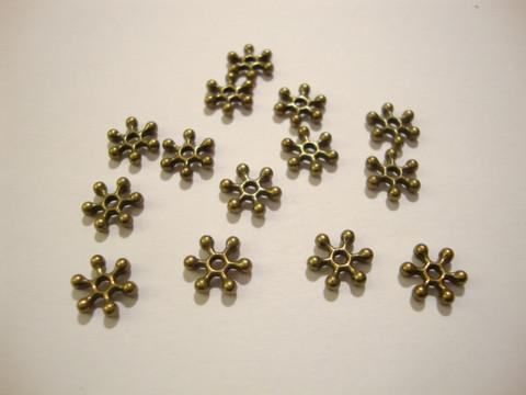 Välihelmi litteä rondelli Lumihiutale pronssinvärinen 7,7 mm (n.45/pss)