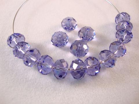 Swarovski kristallihelmi violetti (Tanzanite) rondelli 6 x 8 mm (6/pss)