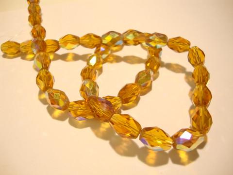 Tsekkiläinen fasettihiottu lasihelmi hunajankeltainen/kulta AB 11 x 8 mm ovaali (10 kpl/pss)