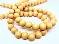 Puuhelmi lämpimän keltainen pyöreä 12 mm (n.34 kpl/nauha)