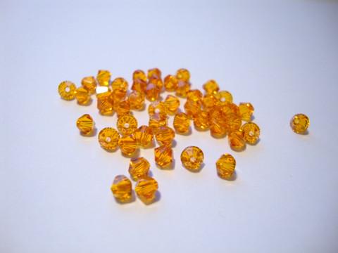 Swarovski kristallihelmi oranssi (Tangerine) bicone 4 mm (5 kpl/pss)