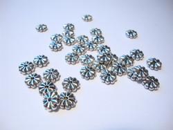 Metallihelmi/välihelmi (rondelli) hopeoitu kukka 7 x 2 mm (30 kpl/pss)