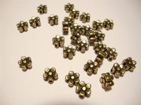 Metallihelmi pronssi pieni kukka 5,5 mm  (30/pss)
