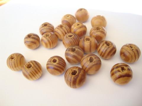 Puuhelmi luonnonvärinen (natural) pyöreä 6 mm, reikä väh. 1 mm (30 kpl/pss)