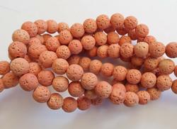 Kivihelmi Laavakivi oranssi pyöreä 8 mm (n. 48 kpl/nauha)
