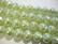 Helmiäislasihelmi 6-fasettinen vaalean vihreä 10 mm (20/pss)