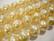 Helmiäislasihelmi 6-fasettinen kermanvärinen 12 mm (10/pss)