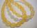 Lucitehelmi hunajankeltainen ovaali uritettu 9 x 6 mm