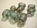 Lasihelmi turkoosi/pronssinvärinen ovaali tynnyri 17 x 14 mm (2 kpl/pss)