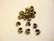 Pronssinvärinen suojahelmi/päällyshelmi 2 mm  kiinnityshelmelle (25 kpl/pss)