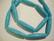 Tsekkiläinen lasihelmi turkoosi opaakki ovaali 26 x 6 mm (15/nauha)