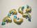Cloisonne helmi turkoosi / kulta kala 20 x 15 mm