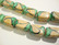 Lamppuhelmi vihreä / beige tynnyri 18 x 11 mm (2/pss)