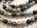 Osterinkuorihelmi musta / oliivi / ukkosensininen / harmaa mix 8 mm (nauhassa n. 48 kpl)