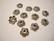 Helmihattu kukkakuvio/pyörre antiikkipatina 10 x 3 mm (30 kpl/pss)