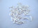 Metallihelmi hopeoitu putki kaareva 10 x 2 mm (30 kpl/pss)
