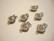 Laatikkolukko hopeoitu Kukka 14 x 9 mm, kiinnitysreikien halkaisija n. 2 mm ( 4 kpl/pss)