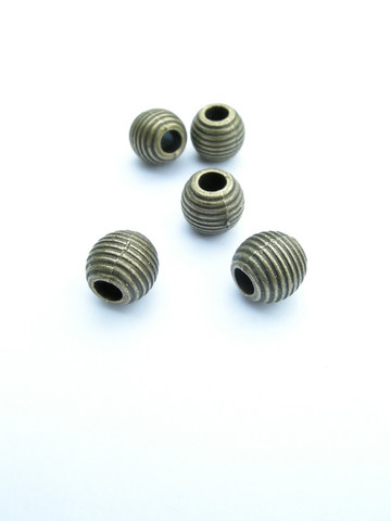 9x8mm Metallihelmi: Pronssi 10kpl