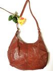 70-luvun punaruskea palanahkalaukku
