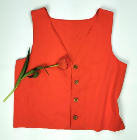 Oranssinpunainen liivi 90-luvulta, L