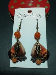 Siivekkäät korvakorut oranssi perhonen