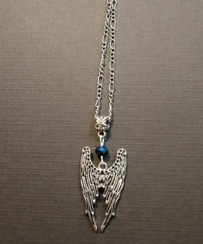 Wings necklace with blue bead