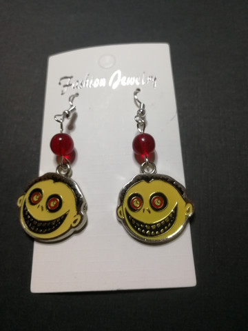 Face earrings with red beads
