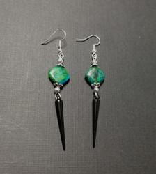 Black spike earrings with green stone beads