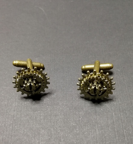 Gold-colored gear cuff-links