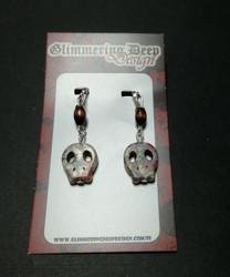Tattooed skulls clip earrings